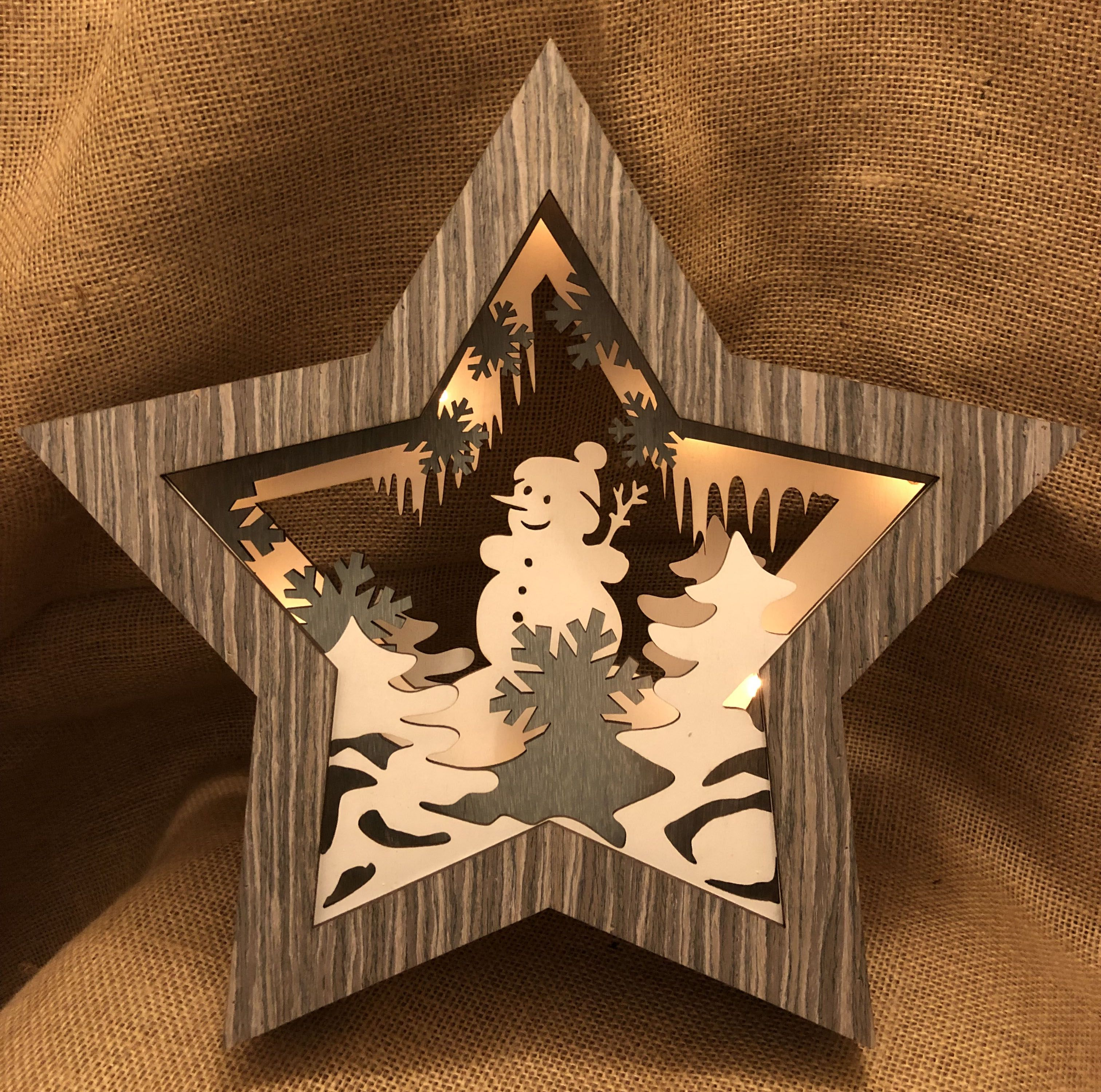 Grey wooden, light-up star with Snowman detail